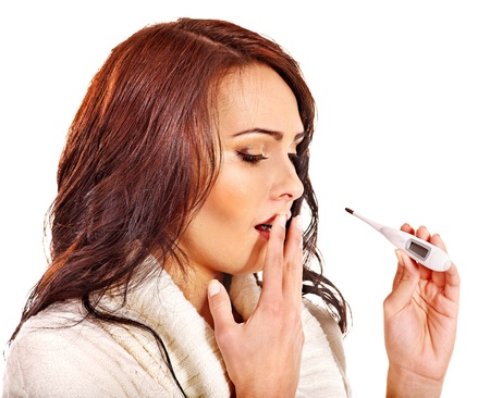 Young woman having  flue taking thermometer. Isolated. Stock Photo - 16222093