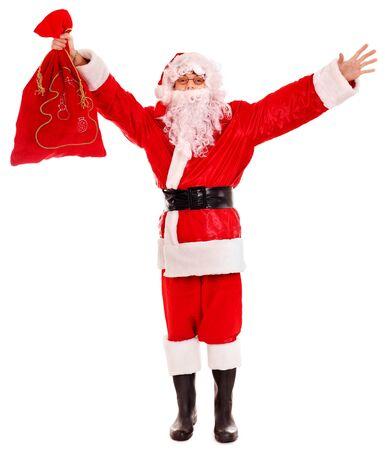 Santa Clause holding gift. Isolated. Stock Photo - 16209340