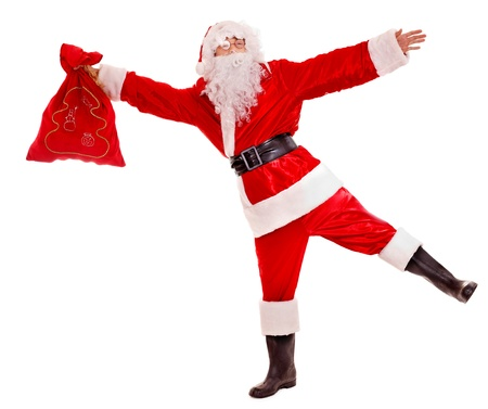 Santa Clause holding gift. Isolated. Stock Photo - 16209337