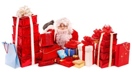 Santa Clause holding gift. Isolated. Stock Photo - 16222044