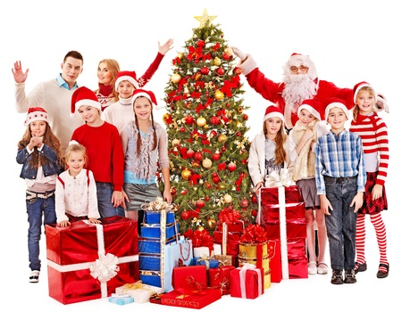 Group of children with Santa Claus and Christmas tree.  Isolated. Stock Photo - 16276038