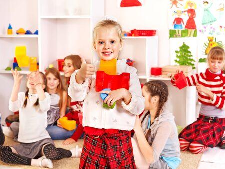 playschool: Children in kindergarten stacking block.