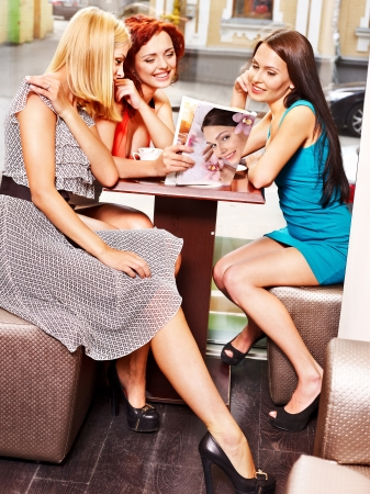 social life: Happy group people drinking coffee at cafeteria . Stock Photo