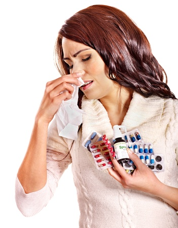 Young woman with handkerchief having  tablets and pills.  Isolated. Stock Photo