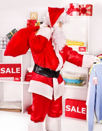 Santa Claus in clothing store. Christmas sale. Stock Photo - 16354708