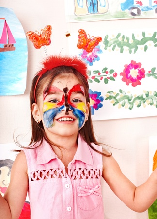 face paint: Child with  face painting in play room. Preschooler. Stock Photo