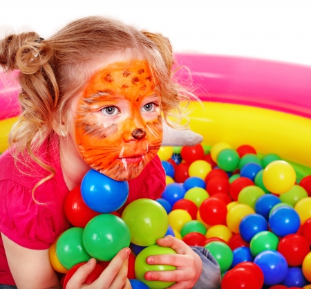 kids club: Little girl play colourful balls. Make up.