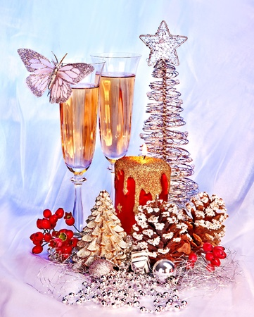 Christmas still life with champagne and candle. Holiday decoration. photo