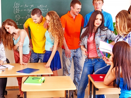 Group happy student in classroom near blackboard. Stock Photo - 16637816