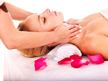 Woman getting facial  massage in beauty spa. Isolated. photo