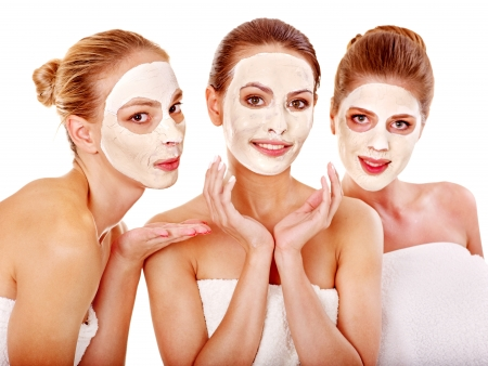 body mask: Group women with  facial mask in beauty spa.