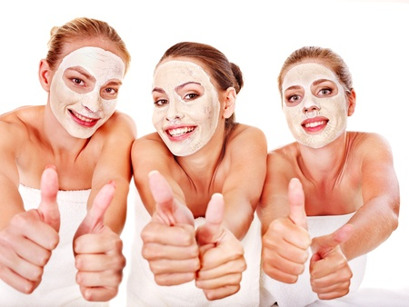 mud girl: Group women with  facial mask in beauty spa.