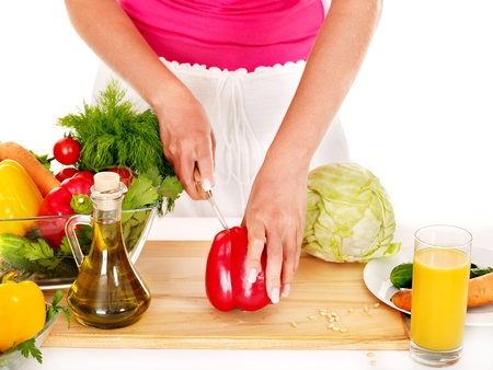 enceinte: Pregnant woman preparing food in the kitchen Isolated. Stock Photo