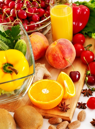 bell peppers: Fresh vegetable and fruit and glass of juice.