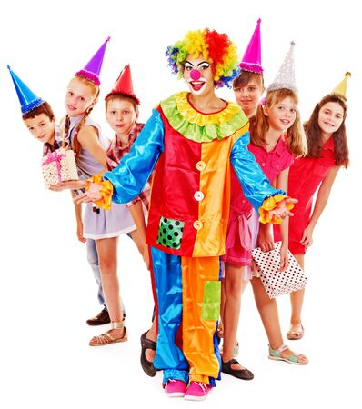 Birthday party group of teen people with clown. Isolated. photo
