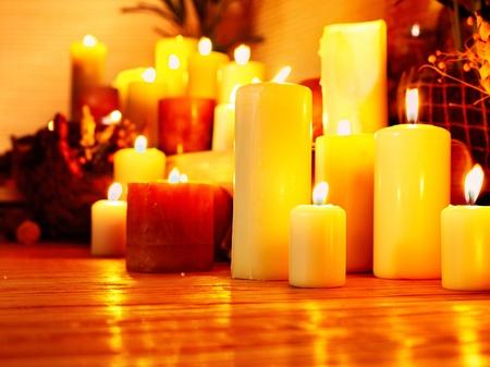 Group burning candle in luxury spa salon. photo