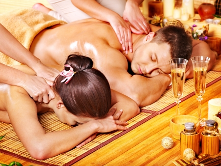 relax massage: Man and woman relaxing in bamboo spa. Stock Photo