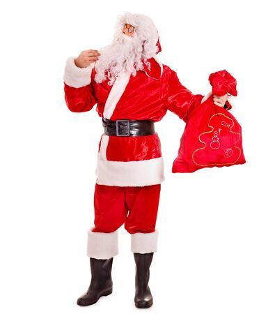 Santa Clause holding gift. Isolated. Stock Photo - 16609948