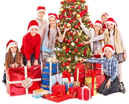 Group of children with Santa Claus and Christmas tree.  Isolated. photo