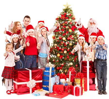 christmas costume: Group of children with Santa Claus and Christmas tree.  Isolated. Stock Photo