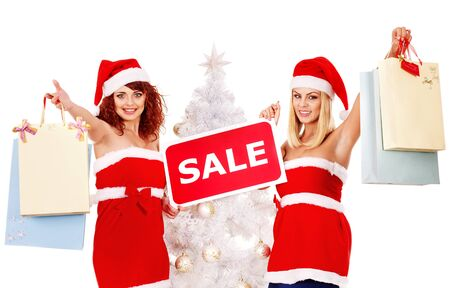Women in Santa hat holding sign saying sale and gift box. Stock Photo - 16613164