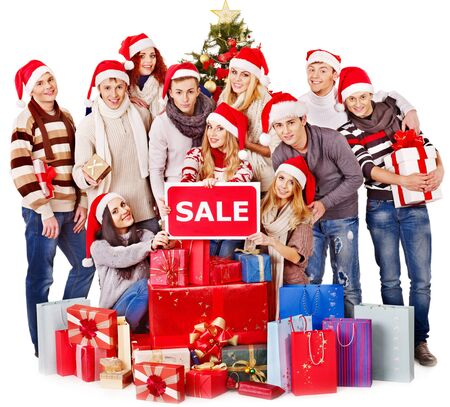Women in Santa hat holding sign saying sale and gift box. Stock Photo - 16595023
