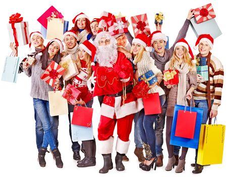 Group people and  Santa holding gift box near  Christmas tree. Stock Photo - 16595024