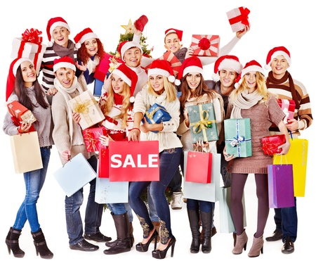Women in Santa hat holding sign saying sale and gift box. Stock Photo - 16610279