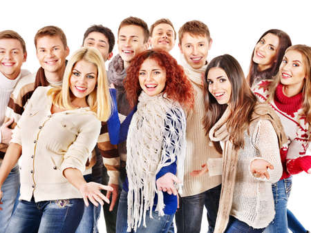 Group happy people wearing winter clothes. Isolated. photo