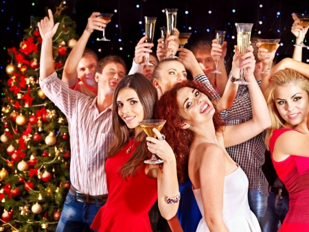 christmas drink: Group people with  champagne dancing at party. Stock Photo