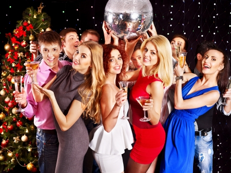 Group people with  champagne dancing at Christmas party. Stock Photo - 16610286