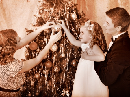 Family with children  dressing Christmas tree. Black and white retro. Stock Photo - 16610259