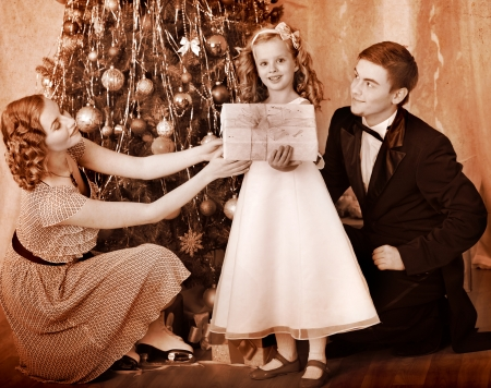 group of christmas baubles: Family with children  dressing Christmas tree. Black and white retro.