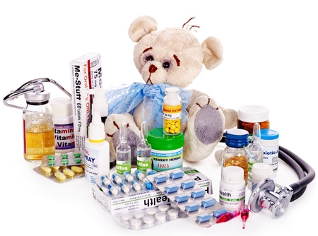 Child medicine and teddy bear. Isolated. Stock Photo