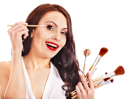 Girl applying makeup by brush. Isolated. Stock Photo - 16734371