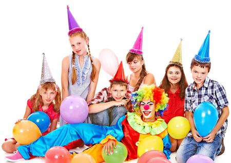 Birthday party group of teen people with clown. Isolated. Stock Photo - 17509050