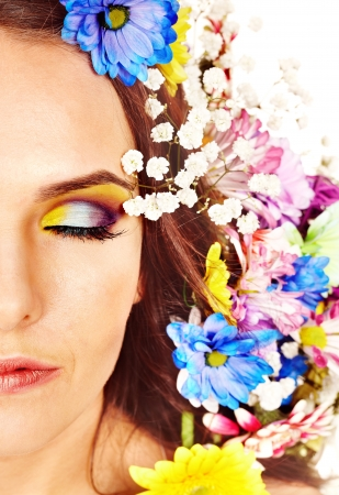 Face of woman with make up and flower. Isolated. Stock Photo - 17423627