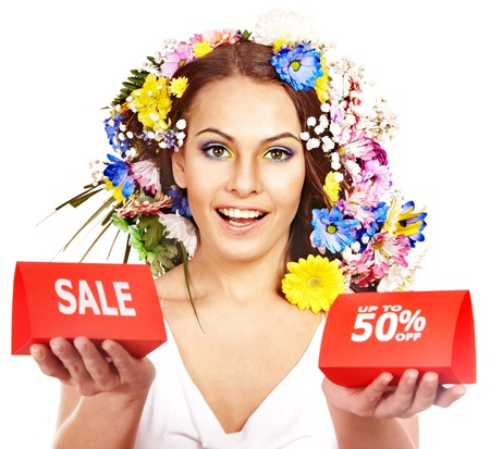 Woman holding sale banner and flower. Isolated. photo