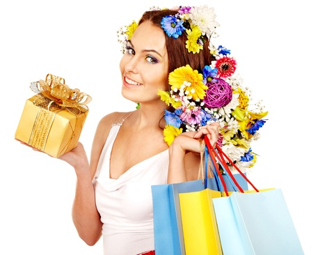 Woman with shopping bag holding flower. Isolated. photo