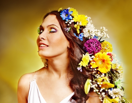 Portrait of woman with flower hairstyle. photo