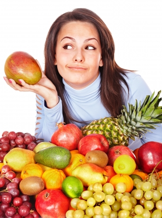 Girl with group of fruit and vegetables. Isolated. photo