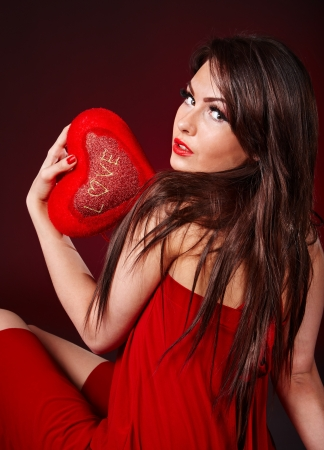 adult valentine: Young beautiful woman holding red heart . Valentines day.