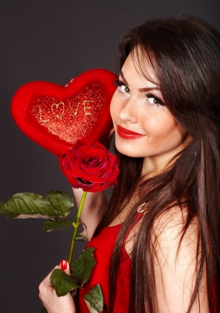 Girl holding red heart and flower rose.  Valentines day. photo