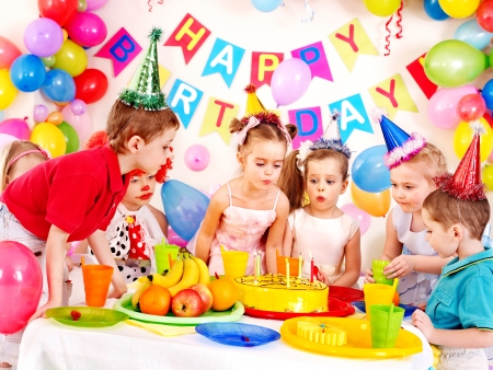 party food: Group of child happy birthday party . Stock Photo