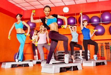 class room: Women group in aerobics class.