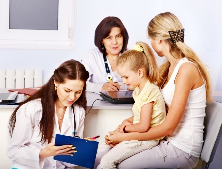 healthy person: Happy family on reception at doctor.