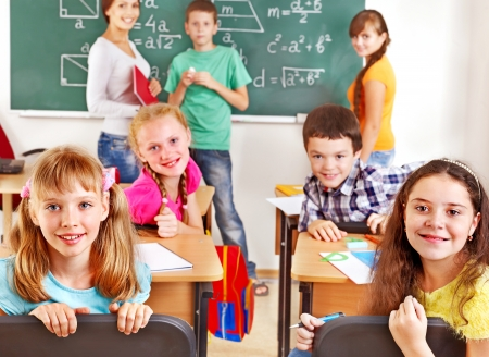 School child with teacher on math lesson. Stock Photo - 17423667
