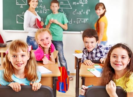 School child with teacher on math lesson. Stock Photo - 17423667