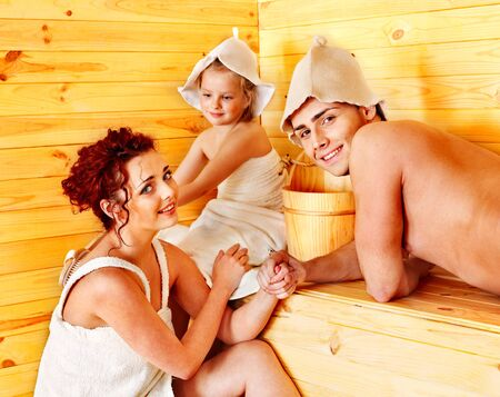 Group people in hat  relaxing at sauna. photo