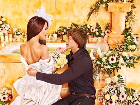 Couple spend wedding night  at luxury spa. photo